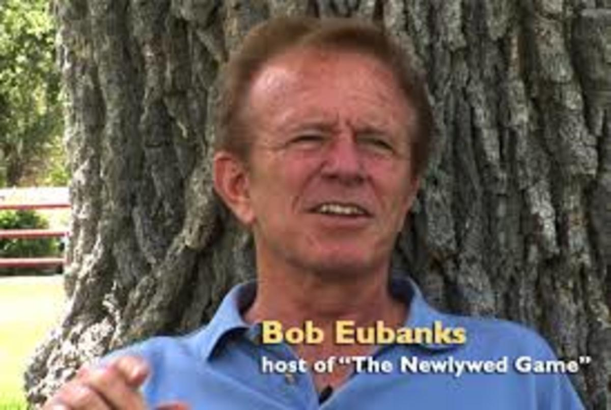 Bob Eubanks leans against a tree.