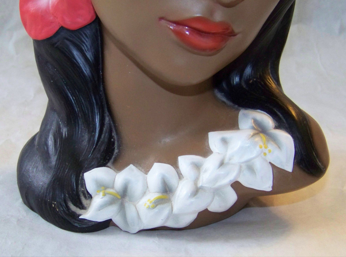Beautiful details lei around her neck. She has the red and gold Lego foil label on felt bottom & marked with the Lego 3762/H marking. She is nine inches tall.