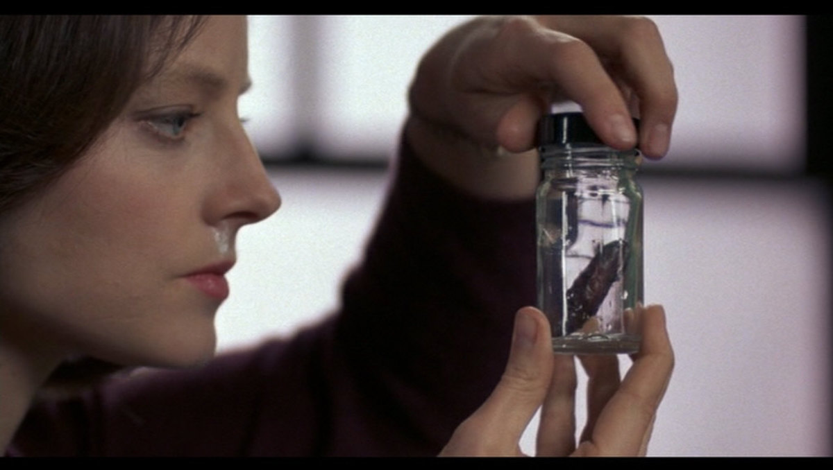 Agent Clarice Starling inspects a moth found inside a victim's mouth.