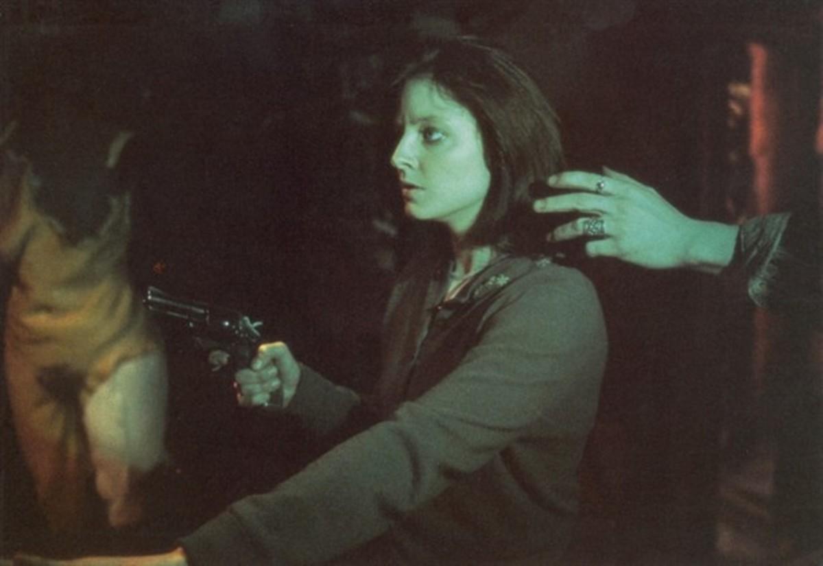 Buffalo Bill plays creeper while Agent Starling has a loaded gun.