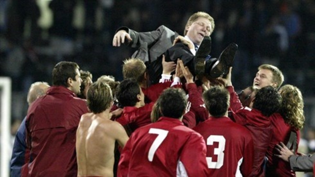 Players and other personnel celebrate by hoisting Latvian manager Aleksandrs Starkovs after Latvia secured a berth at Euro 2004 with a 2-2 draw on Nov. 19, 2003.