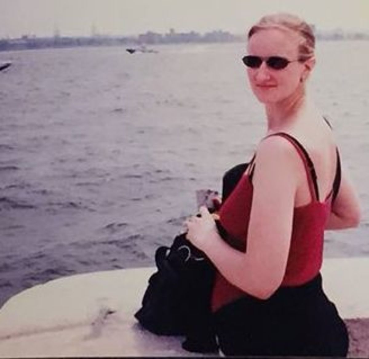 """The author in 1998, on the ferry to Ellis Island.  The trip to New York was funded by my law firm.  People told me I should """"get rid of it"""" so I wouldn't ruin my figure."""