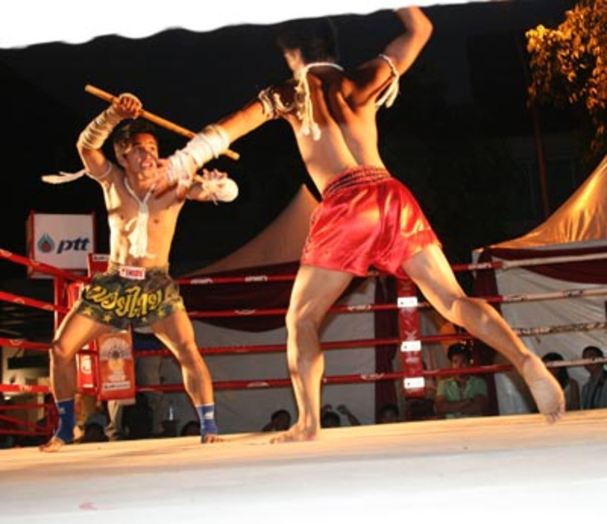 Krabi Krabong stick fighting with Muay Thai shorts and Muay Boran wrappings. In Ancient times, Muay Boran and Krabi Krabong was used in warfare.