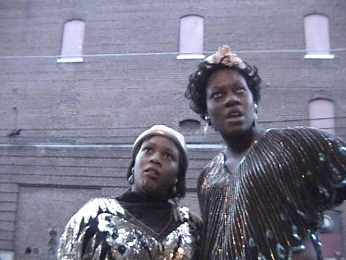 This re-enactment portrays a rambunctious Ma Rainey (right) and Bessie Smith (left) causing a ruckus on Beale Street.