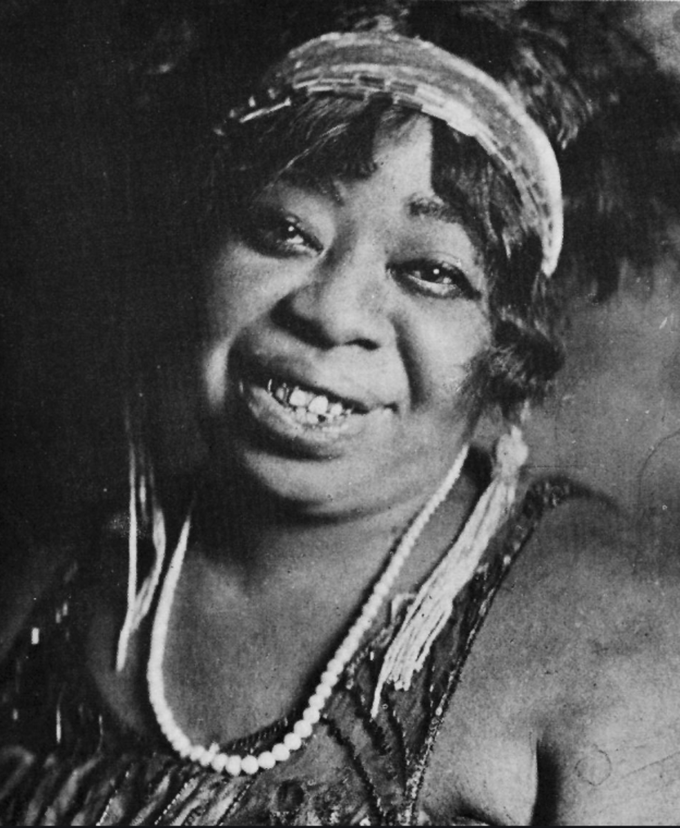 "Often performing on Beale Street, ""The Home of the Blues,"" in Memphis, Tennessee, Ma Rainey was known for her music and brawling. She was also said to be a practitioner of Hoodoo magic."