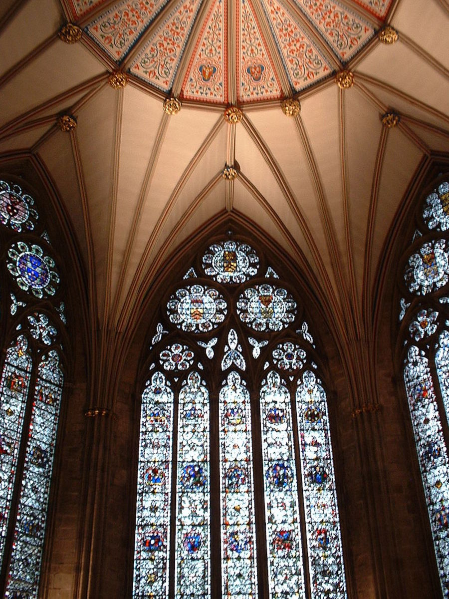 Windows in the Chapter House at York Minster show the equilateral arch with typical circular motifs in the tracery.