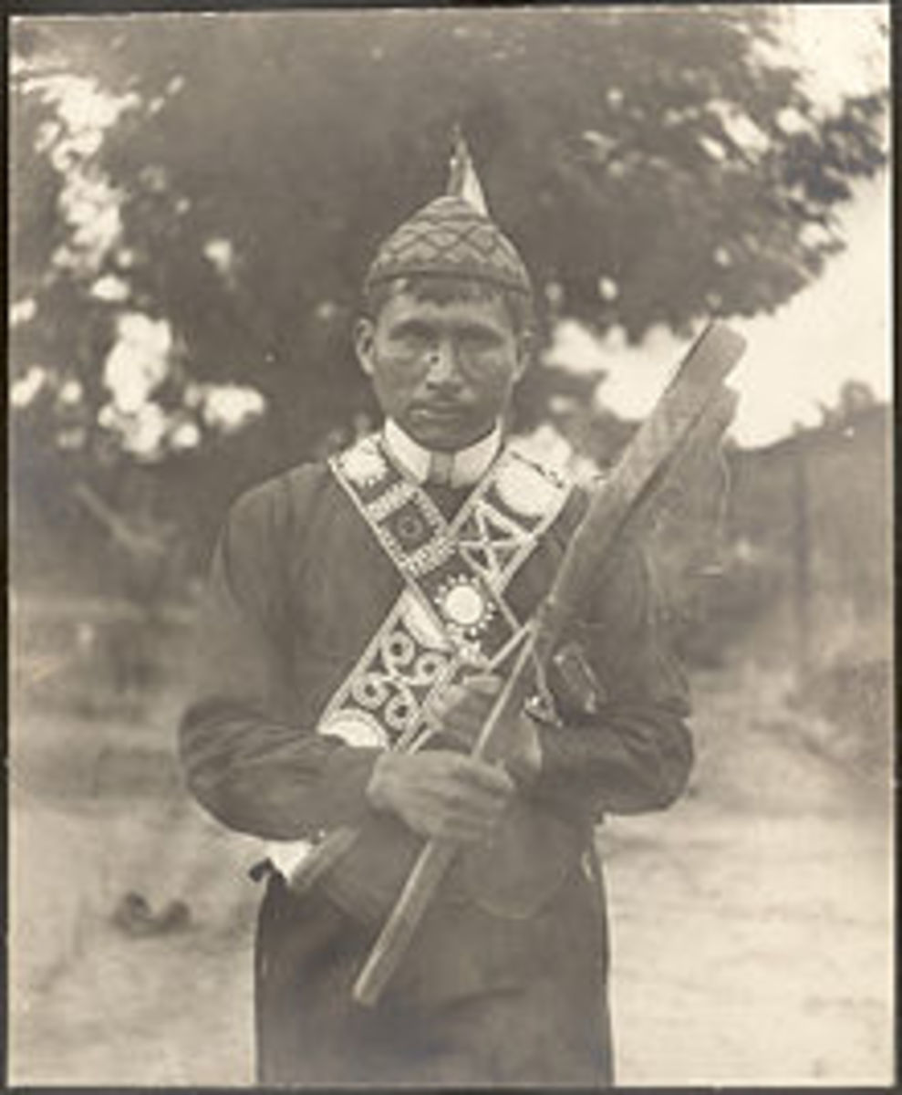 Jim Tubby 1867-1935 Mississippi Choctaw holding 2 stickball game sticks