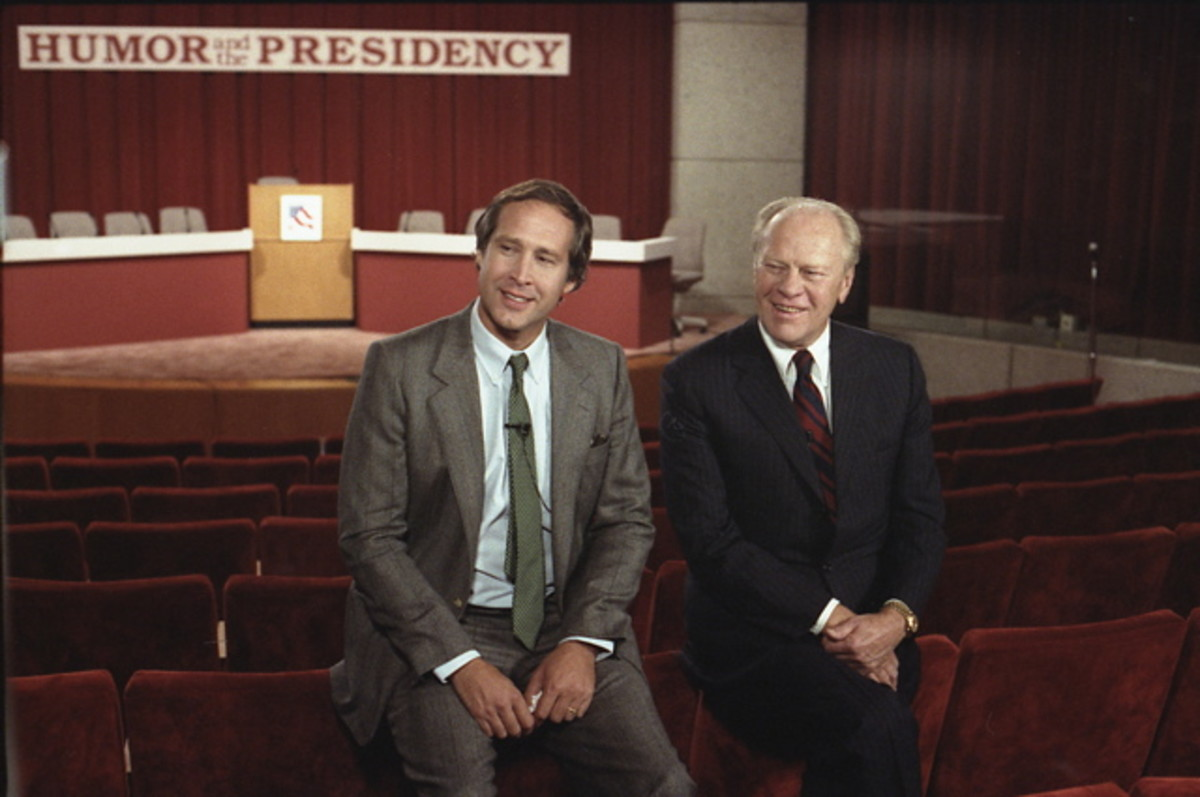 Gerald Ford and Chevy Chase sit before the Conference on Humor and the Presidency held at the Gerald R. Ford Museum in 1986.