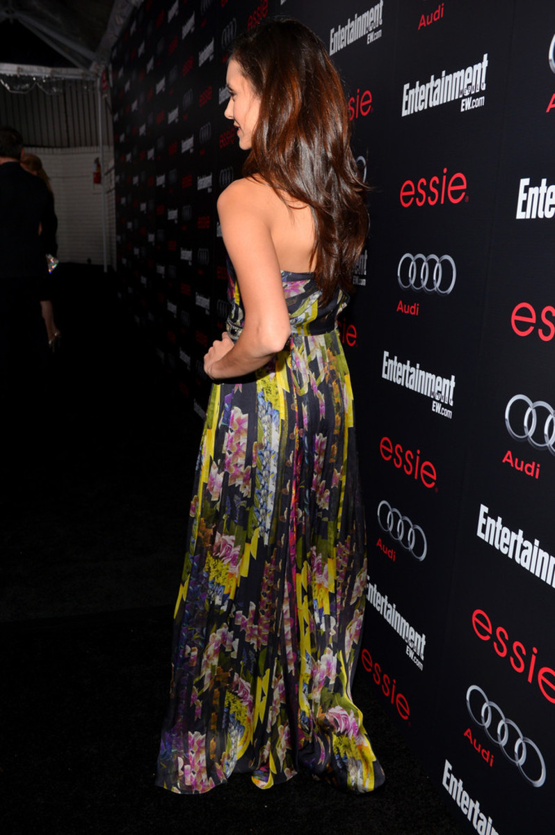 Actress Nina Dobrev has her back turned during this pre-SAG party but her dress looks amazing!