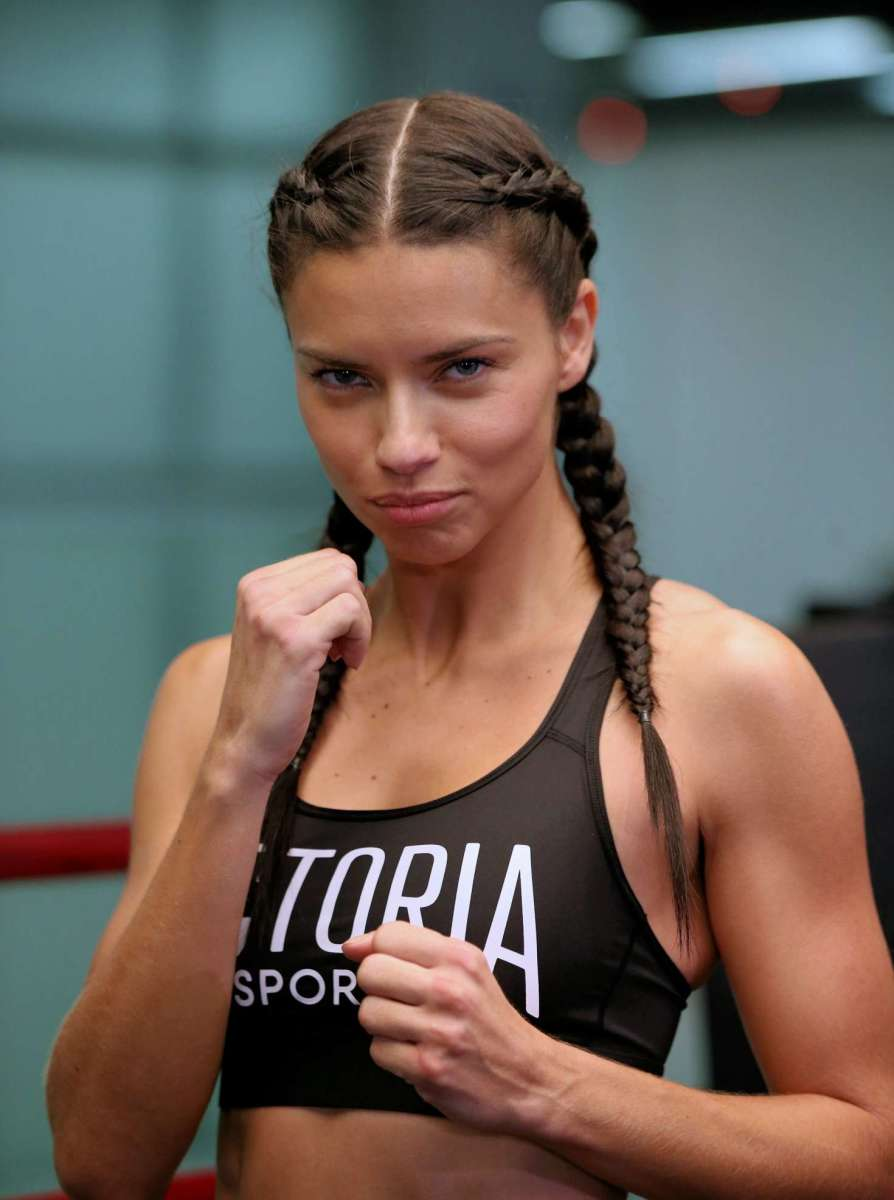 Adriana Lima hosting an event called Train Like an Angel. It seems she is getting ready to do some boxing practice.