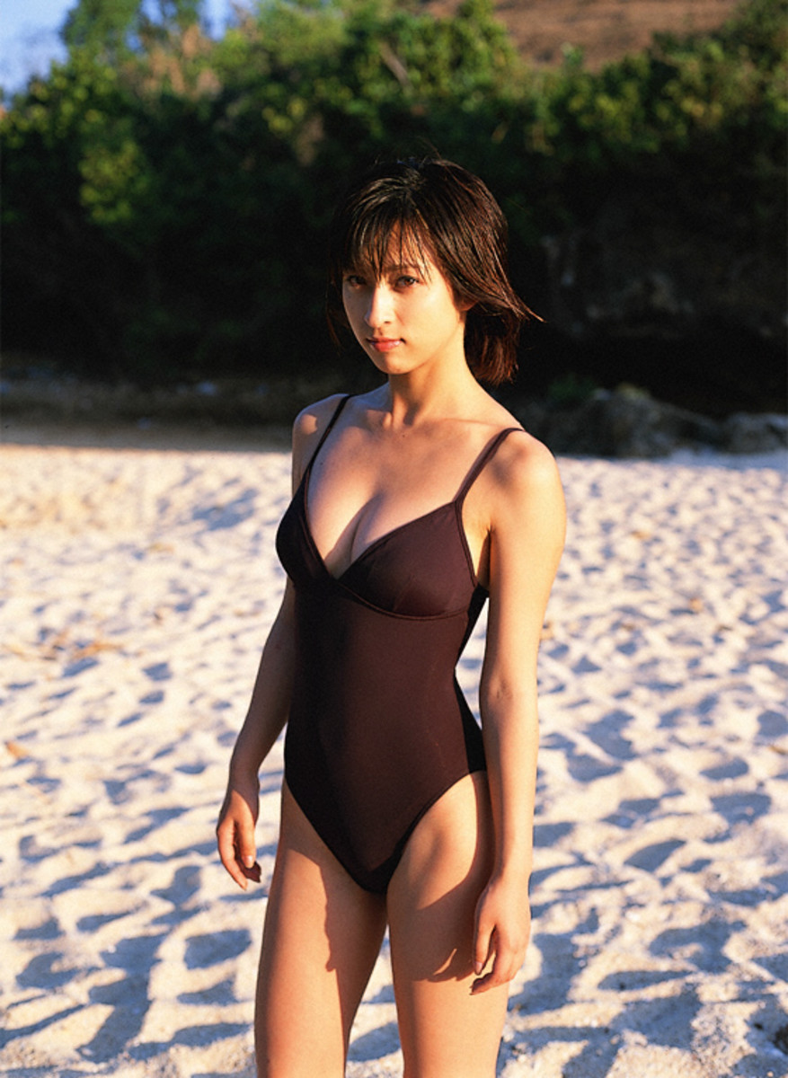 Kasumi Nakane is seen here at a beach somewhere as she is standing on the sand.