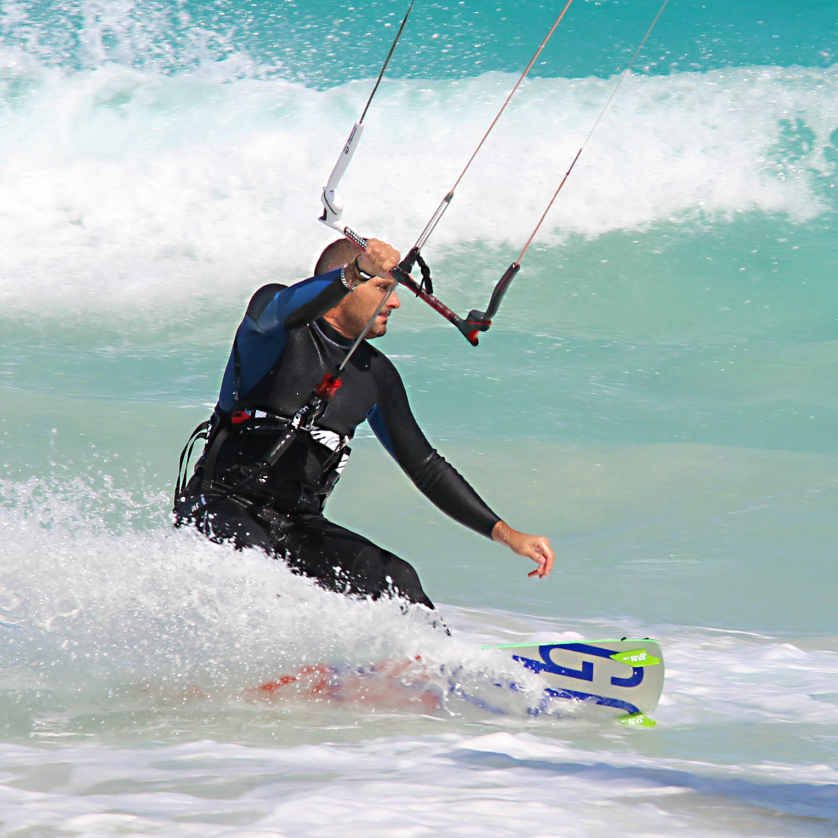 A kiteboarder at Corralejo riding the waves
