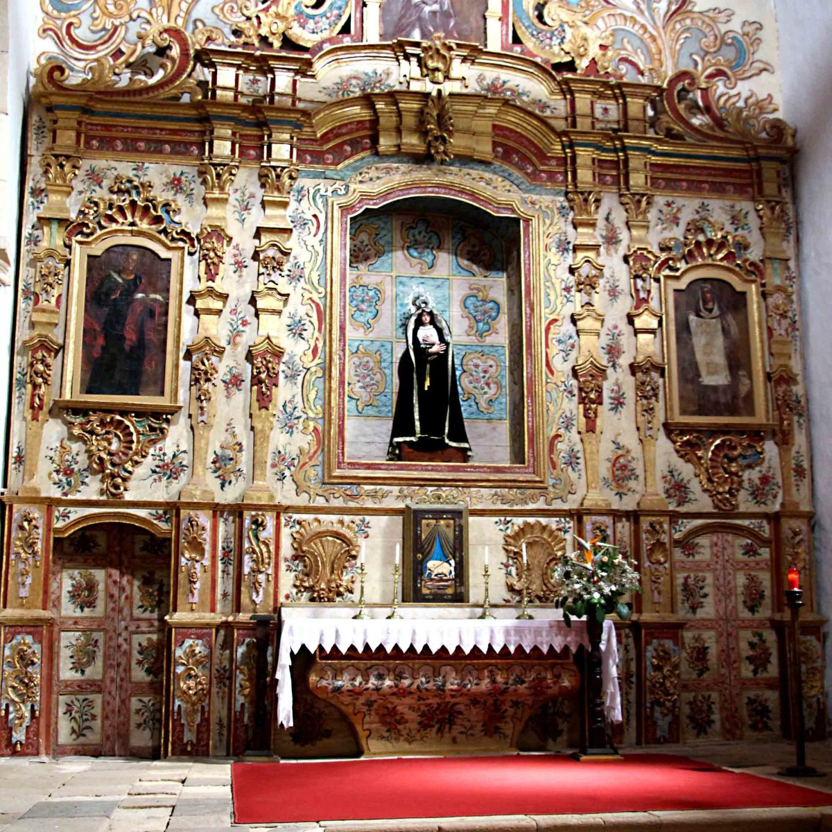 The ornate interior of the Church of Nuestra Senora de Regla in Pajara. Behind the altar is the figure of the Madonna. The main entrance is shown elsewhere on this page