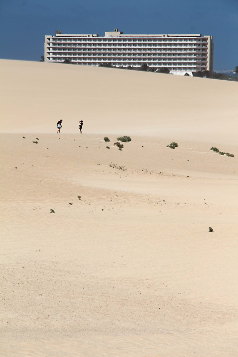 The ClubHotel Riu Oliva Beach across the expanse of sand dunes near Corralejo. The extent of these dunes can be guaged by the two tiny figures in the middle distance
