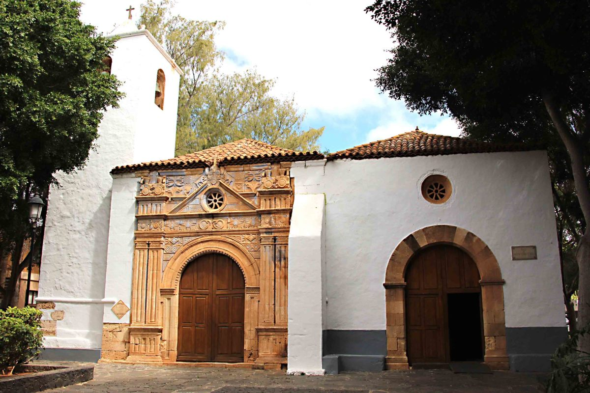 The decorative entrance of the 17th century Iglesia de Nuestra Senora de Regla in Pajara  is believed to exhibit Aztec influences brought back by Spanish conquistadores, including sun, snake and jaguar depictions
