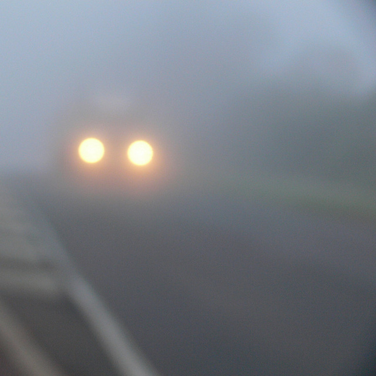 There was nothing but the encroaching fog on each side of the road and an unfamiliar hill.