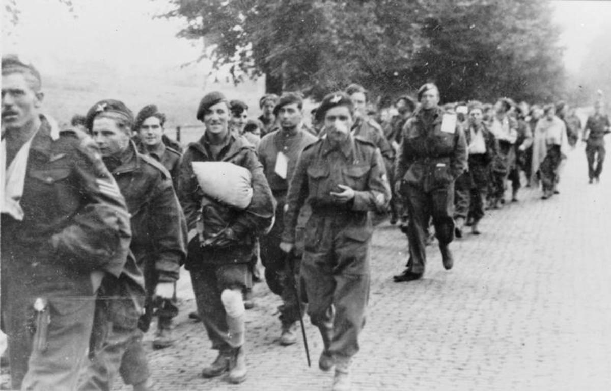 British paratroopers led away as POWs were subjected to physical abuse on their way to camps in the east,. long hours spent entrained without food or water - two and a quarter thousand reached safety back across the Rhine
