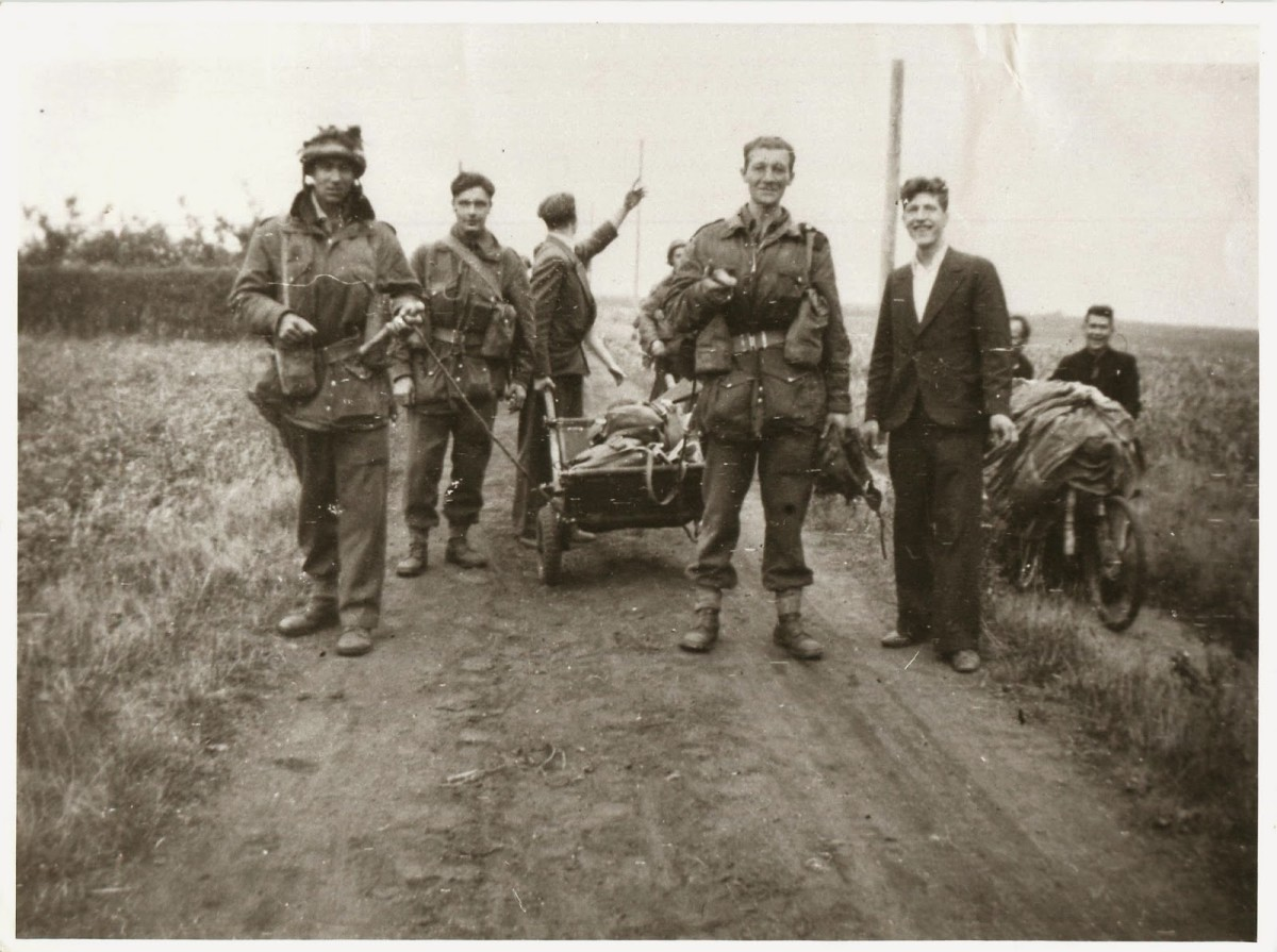 US Paratroopers pose for a snapshot by the road to Arnhem with Dutch civilians