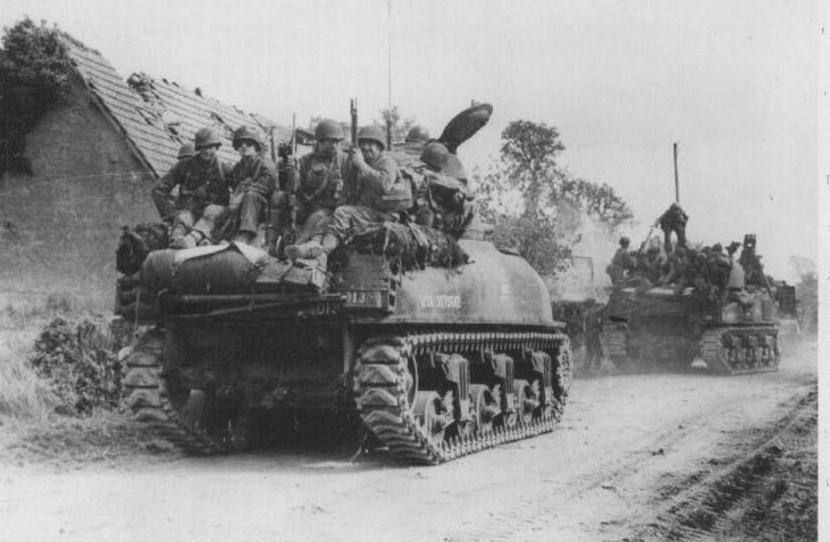 American paratroopers hitch a lift from XXX Corps  - on US Sherman tanks