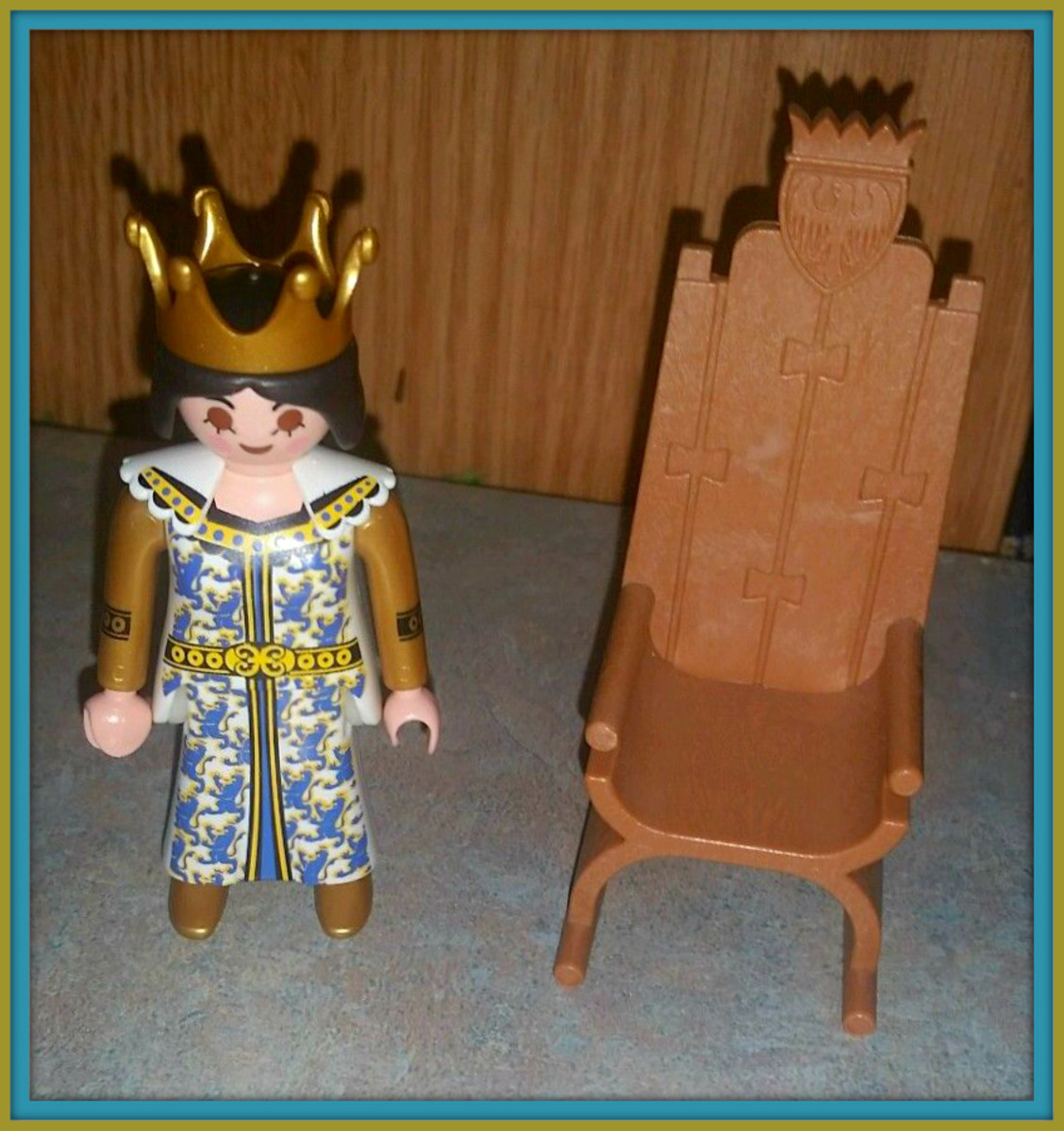 Beautiful Playmobil Medieval Queen & Throne from  the Lion's Castle. She is wearing a nice crown that matches her gown and sits in the thrown very nicely.
