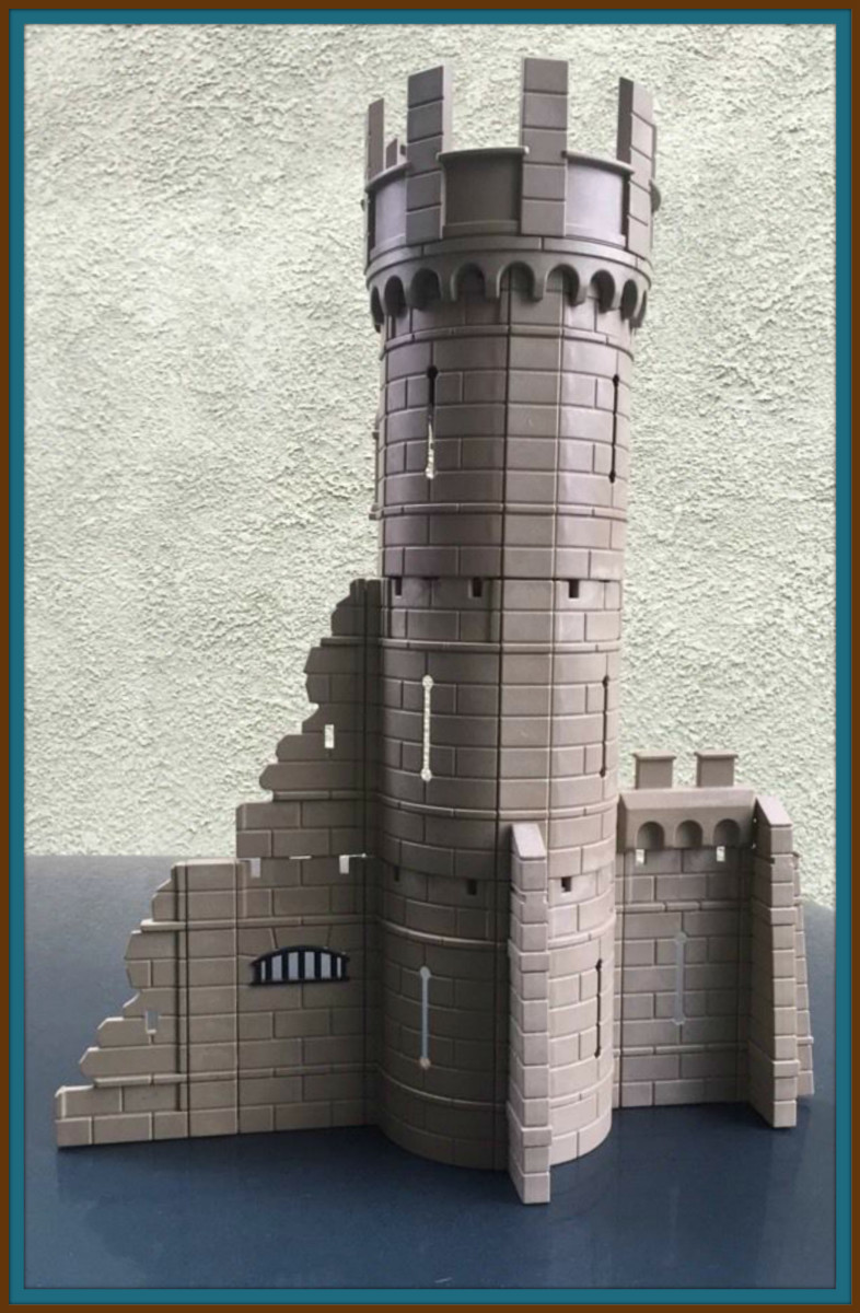 Playmobil Knights Castle Defense Tower, A lovely gray in color, and three levels tall. It is a custom creation & does not have a model number. This is an older style of Playmobil castle with connectors known as the click together building system.