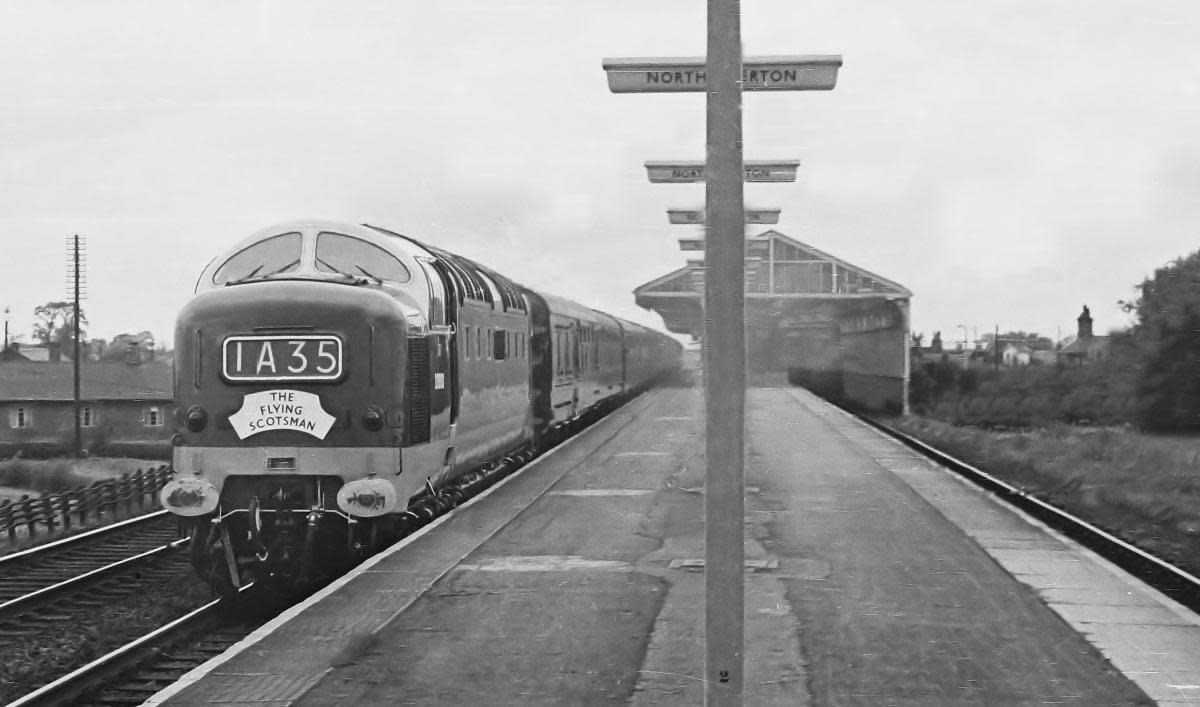 A new era ushered in... unidentified Deltic diesel bears the nameplate for the Down 'Flying Scotsman' service (10 am from Kings Cross, London) on her way non-stop through Northallerton. Nearest stopping point was Darlington (Up or Down)