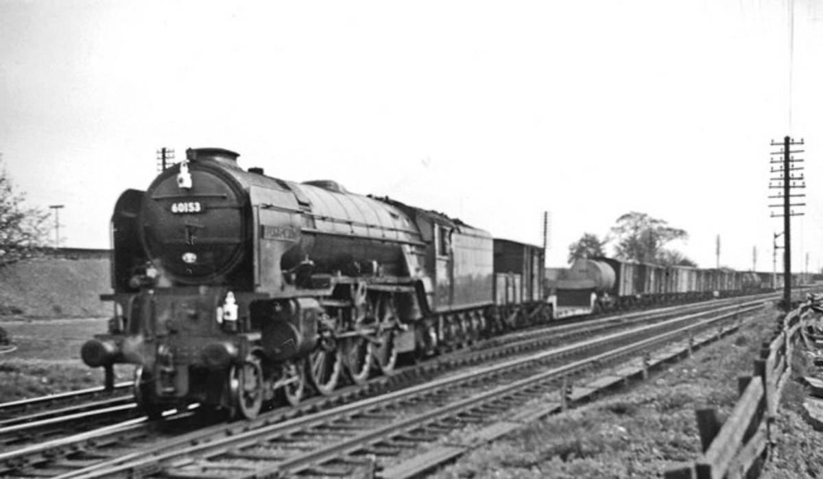 Near the same place, Peppercorn A1 Pacific  60153 'Flamboyant'' (named after a racehorse)  also heads down to the Low Level line for Teesside with a freight off the main line