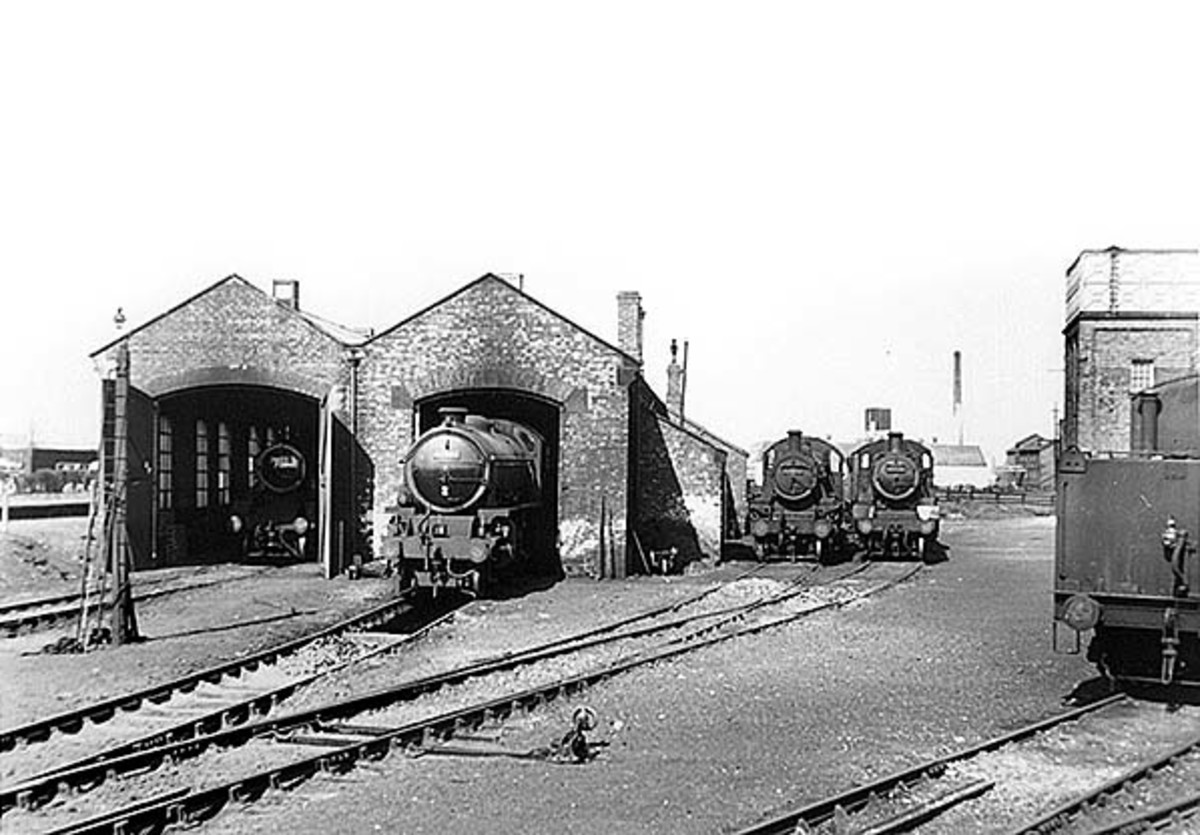 Northallerton's motive power depot in 1958 seen from the north. The depot was squeezed between the low level lines and the higher East Coast Main Line, visible from the back of the Down platform