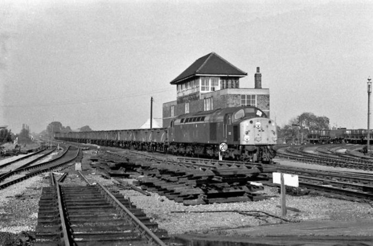 Rationalisation of the junction in 1970 - English Electric D252 passes Northallerton's signal box southbound with a train of BR 16 ton mineral wagons