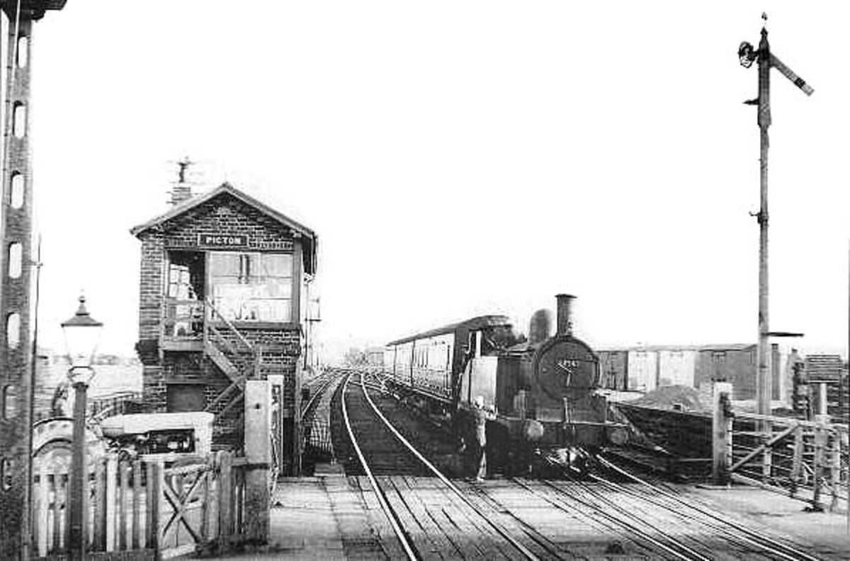 Picton in the closing year of the branch (1954). The signalman takes the single line token from the driver of a Class G5 0-4-4 tank locomotive on its way into Picton's Down platform, back to Stockton-on-Tees. Stockton mpd (51E) had five of the class