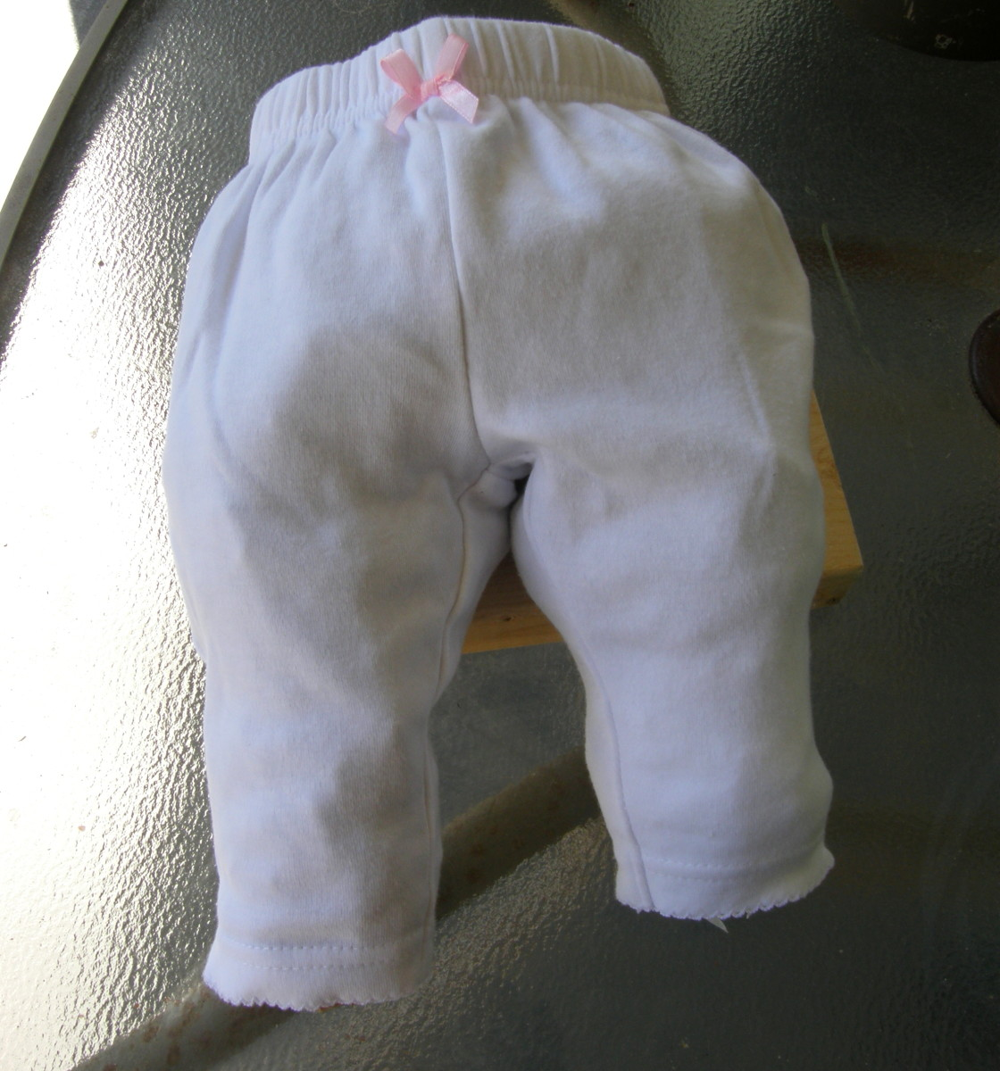 I decided to preserve a small pair of pants that my granddaughter no longer wears. I am doing this as a free-standing sculpture.