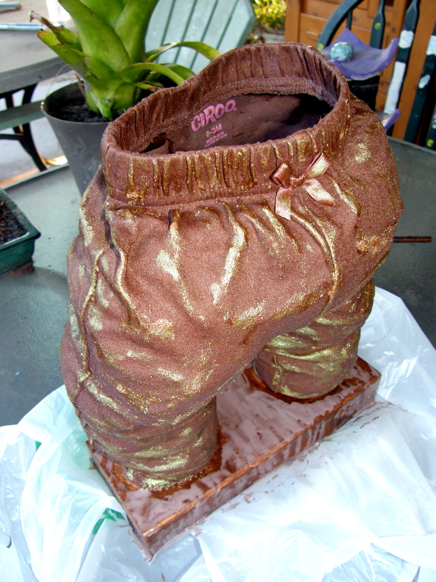 The sculpture is completely dry and I have removed the plastic bags from the inside.  The base has also been painted.  Golden and copper powdered pigments have been added for highlight effects.