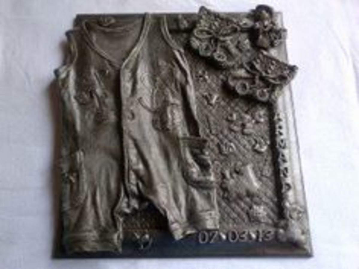 Baby clothes preserved on canvas using Grey Paverpol