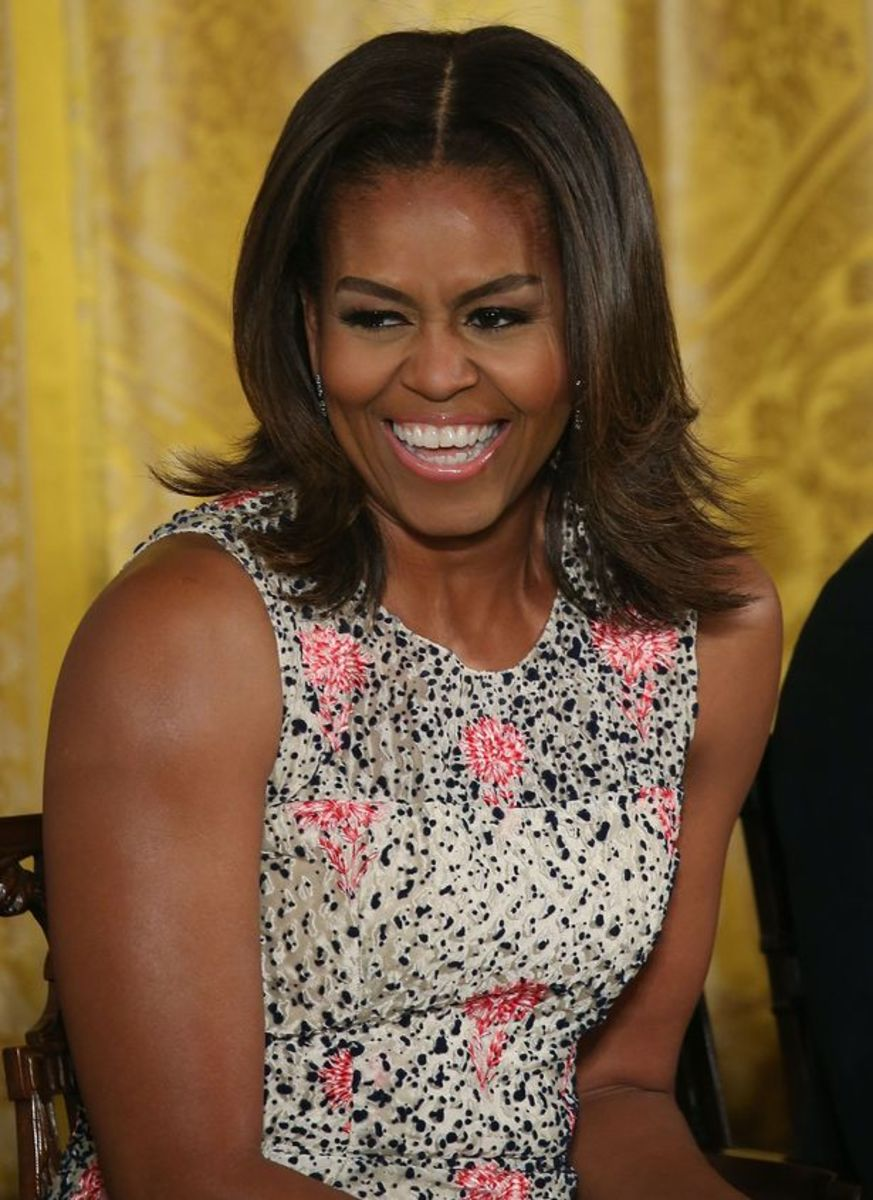 First Lady Michelle Obama doesn't show the stress on her face as on her husband's.