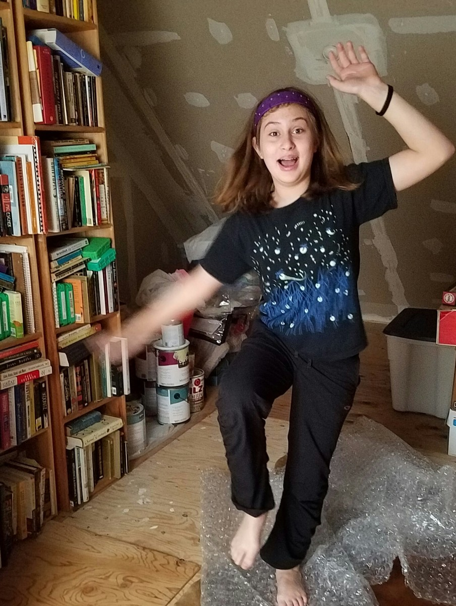My daughter dancing on bubble wrap in our attic