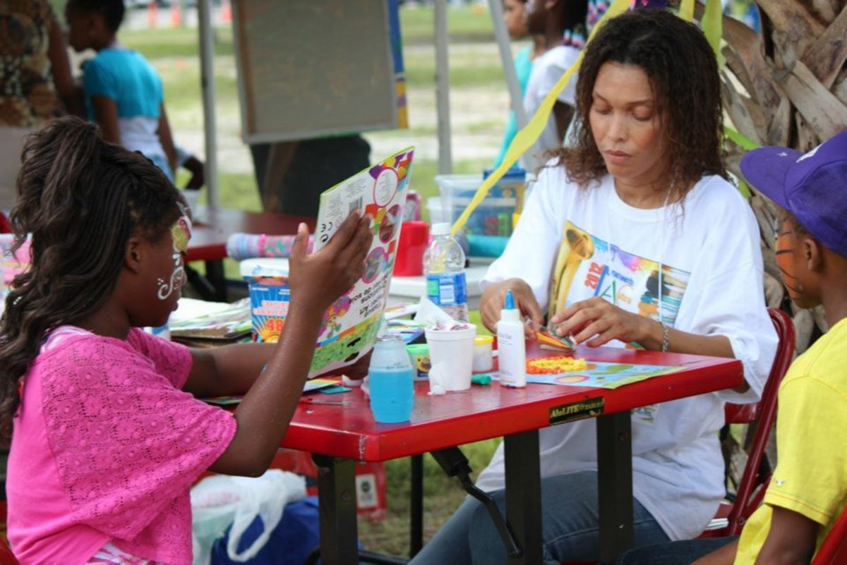 Working with a group of children during the Juneteenth Festival