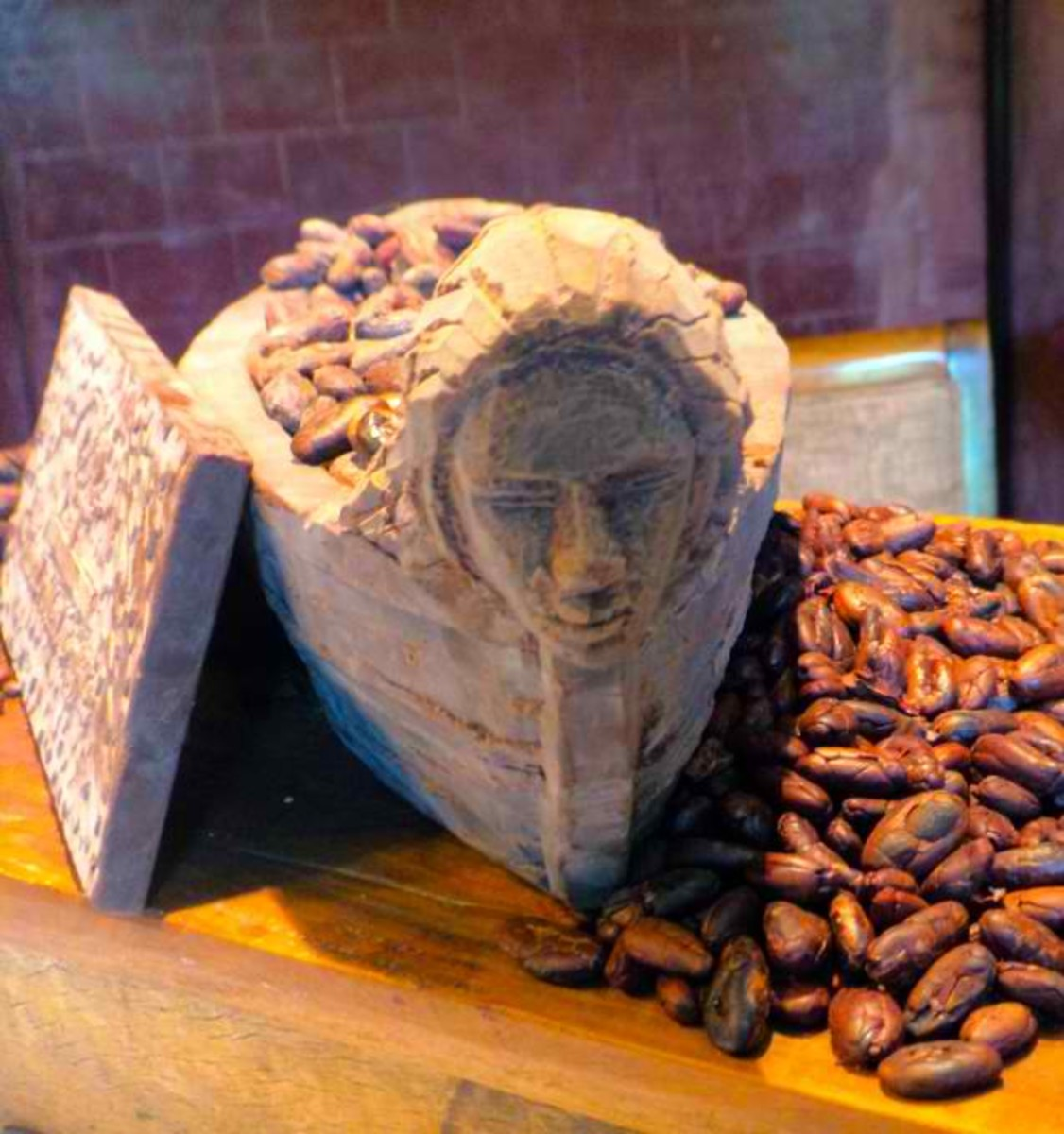 wood carving of maria cacao in her ship