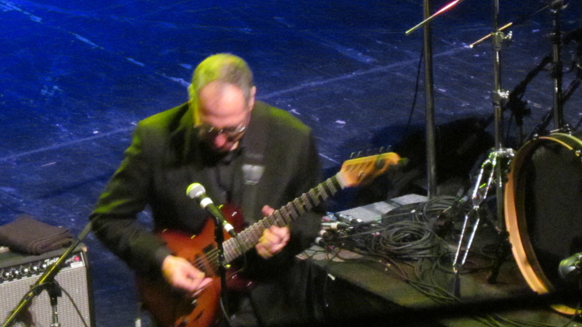 Guitarist Chuck Loeb, get down during his performance at the jazz fest.