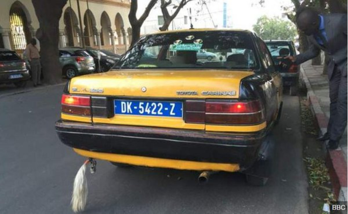 Senegalese taxi with a goat tail on it