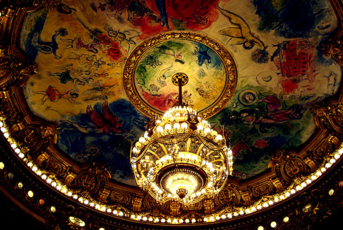 The Chandelier hangs as a magnificent ornament in the opera house.