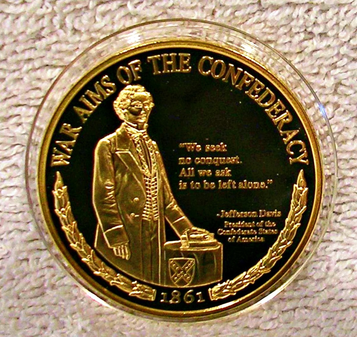 "Confederacy War Aims Civil War coin with Jefferson Davis ... ""We seek no conquest.  All we ask is to be left alone."" Made by the American Mint  this commemorative Medallion is part of their Civil War collection."