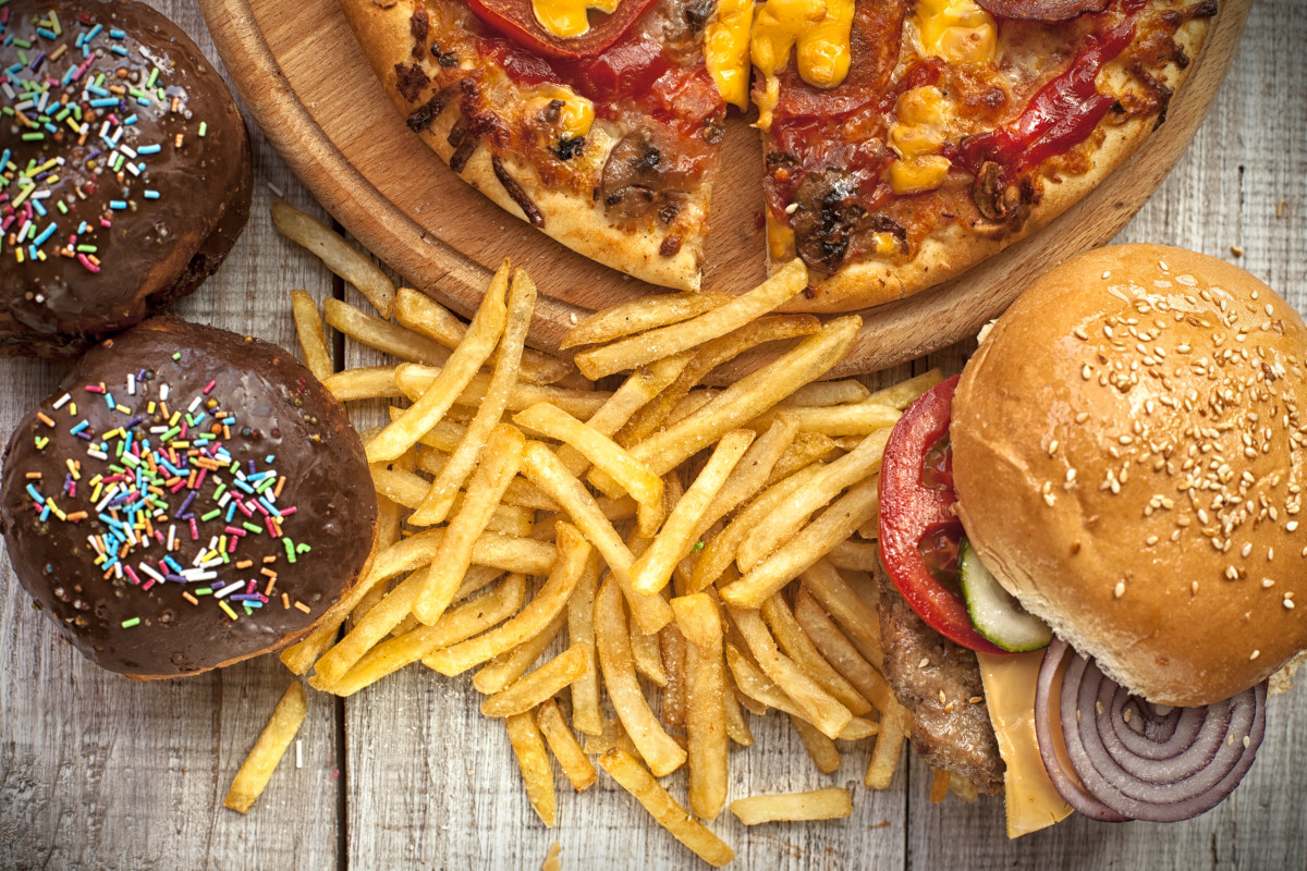 Trans fats are abundant in fried food, such as chicken nuggets and French fries ... margarine, vegetable shortening and is thus found in commercially prepared baked goods, such as cookies, doughnuts, muffins and pizza crusts.
