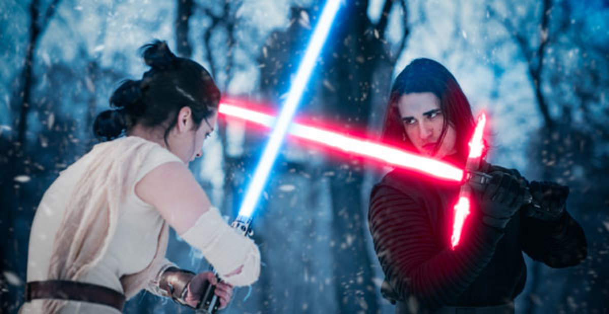 Rey and Kylo Ren having a little light saber and costume play