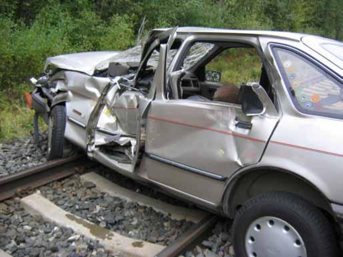 Don's Ford Escort was crushed by an eighteen wheeler, pinning his legs under the dashboard. Jaws of Life were required to free him from the wreckage. (Not the actual wreckage photo.)
