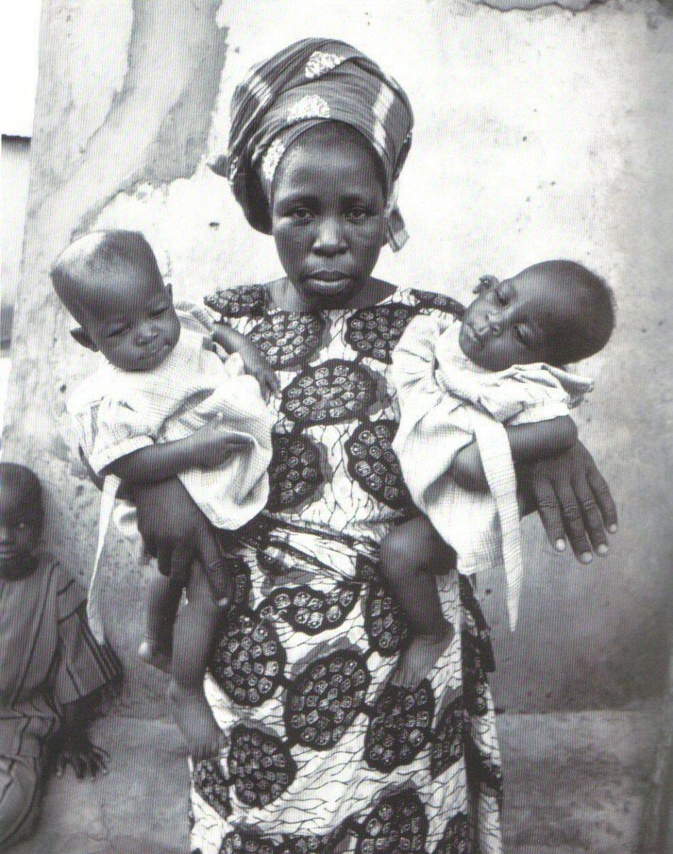 A Yoruba Woman holding twins