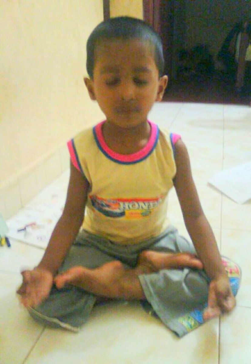 An Indian boy practicing yoga