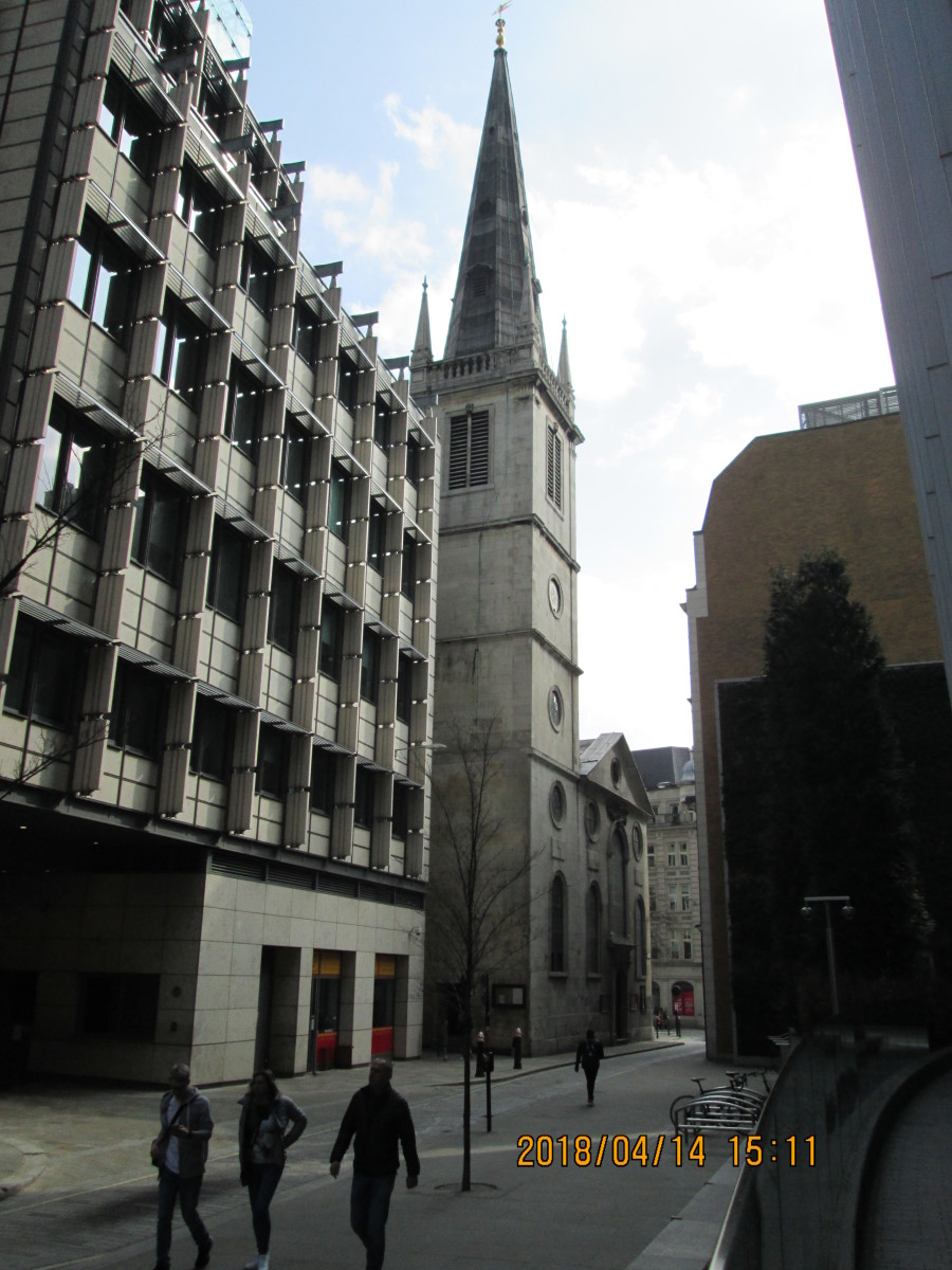 Between office blocks and shops is the church of St Margaret Patten. You see the tower at an oblique angle before the rest of the building comes into view...