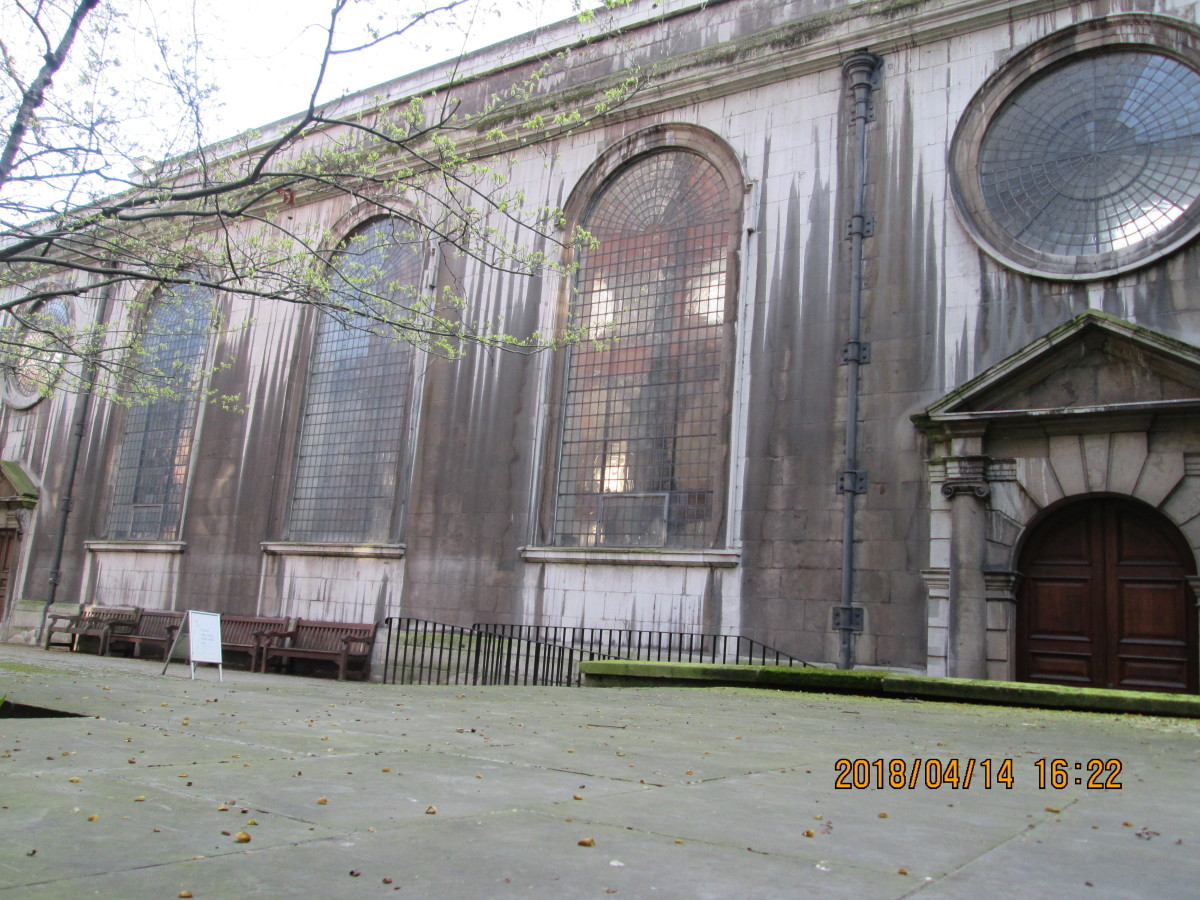 St Bride's flagstoned Church Yard, with its high, wide decorative windows - on the other side of the narrow pathway is 'The Bell', a pub I visited several times during my employment in Fleet Street during the 1970s and 1980s until 1986