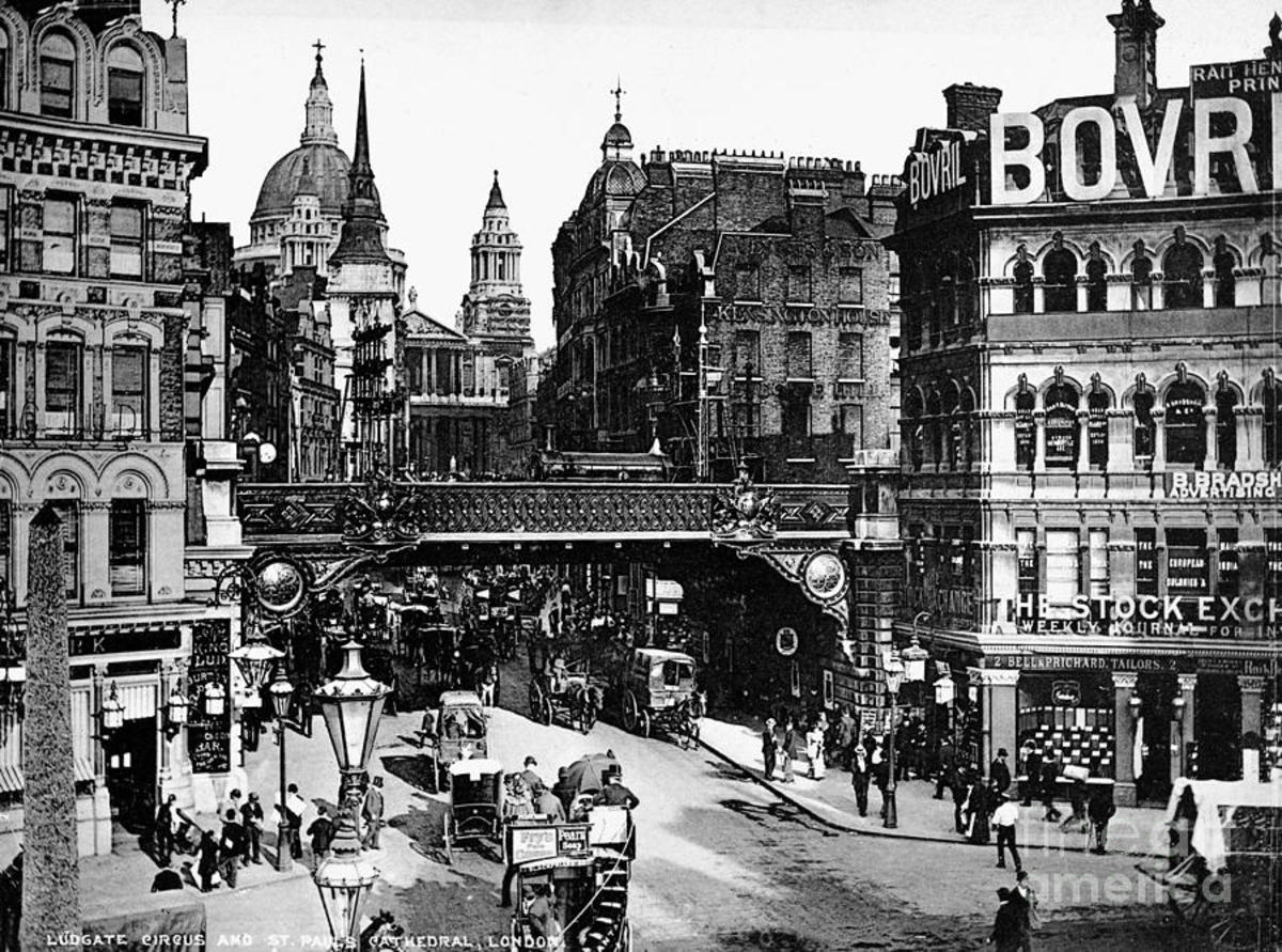 From around the same place, St Paul's nestles behind office buildings and shops at the top of Ludgate Hill where old St Paul's stood until 1666. The railway bridge  in Granger's pre-WWI photo took the line from Blackfriars to Holborn Viaduct Station