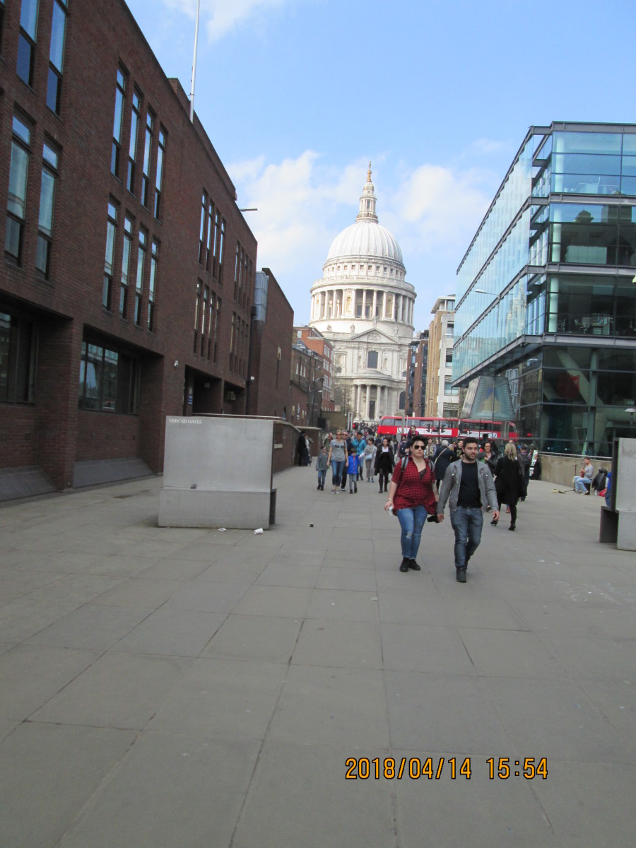Not quite ancient and modern: a sighting of Wren's masterpiece St Paul's Cathedral seen from the Millenium (pedestrian) Bridge approach. And to the right...